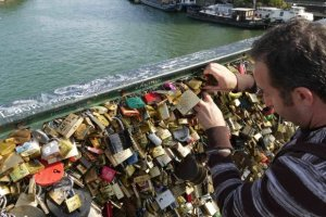 Tourist, Ian installing his and Josie's padlock on Pont des Arts