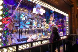 Printemps Christmas Window Prada Child looking at window and the bears