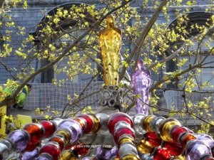 Place Colette Metro Palais Royal with glass figures on top of the decorative red, silver, purple and gold glass balls