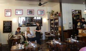 Interior view with Anne, the owner, speaking to a regular customer