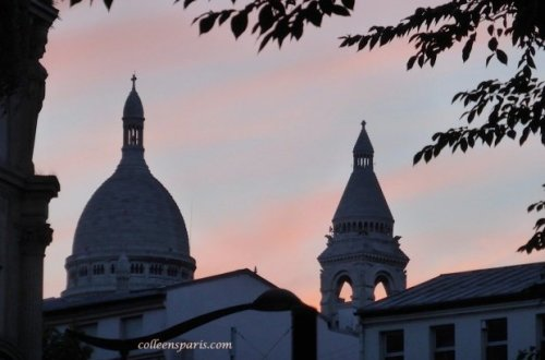 Sacre Coeur in the sunset near Barbes in front of Luxor Cinema