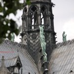 Statues of evangelists on Notre Dame One looking at spire represents Viollet le Duc and at the same time Saint Thomas, patron saint of architects