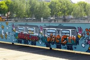 Official graffiti Pont des Arts, Institut de France in background