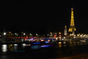 Eiffel Tower as a backdrop to Pont Alexandre III on a Paris photo night walk capturing movement as a boat cruises by