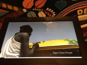 """Pape Omar Pouye painting the """"car rapide"""" Bonne Mère located now in the Musée de l'Homme"""