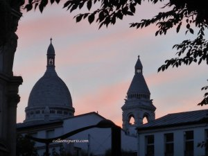 Sacre Coeur at sunset from Barbes Rochechouart boulevard Magenta in the background