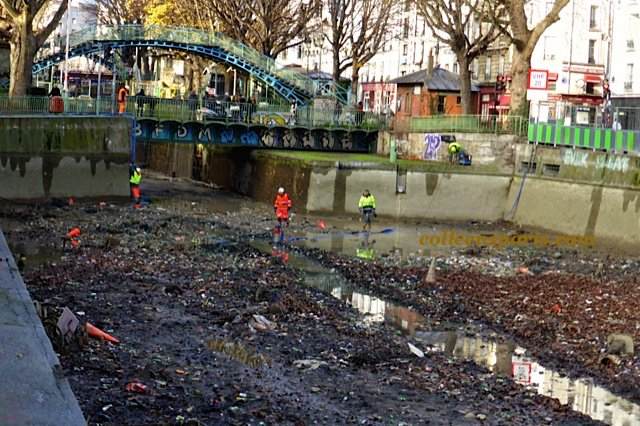 Workers in the Canal Saint Martin pumping out the water