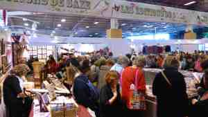 Book stand with many women thumbing through the craft books