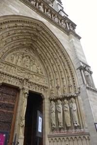 Angels of the arches, dressed as altar servers at Saint-Anne's door, Notre-Dame de Paris