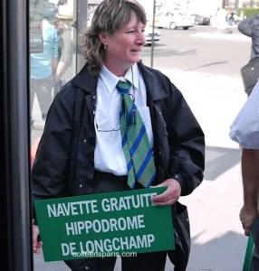 RATP employee holding sign for Free bus (navette) to Hippodrome de Longchamp