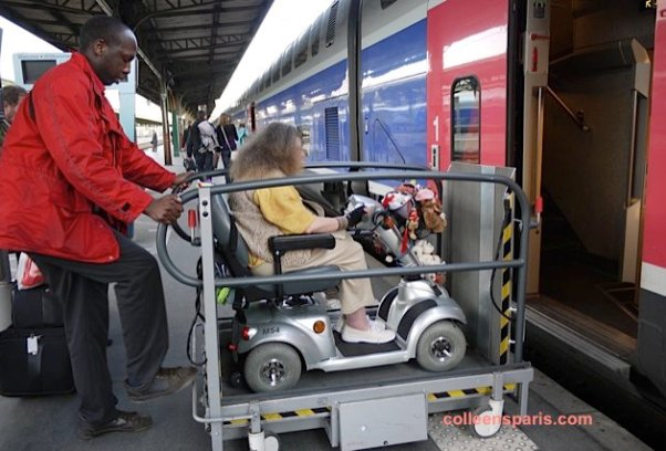 SNCF staff helping electric scooter access TGV