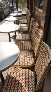 Bistro Chairs lined up along rue Birague near Places des Vosges