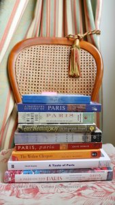 Some of my Paris books stacked on a chair with passementier, drapes and Jouy-en-Josas fabric