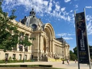 Photo showing front entrance to Petit Palais and poster for Paris Romantique