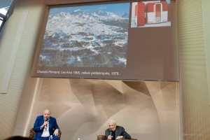 Jean-Louis Cohen and Frank Gehry below projected images