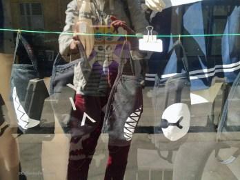 Shop window with black fashion masks Rue Keller