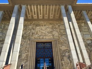 Entry to the Palais de la Porte Dorée facade covered in bas-relief sculpture