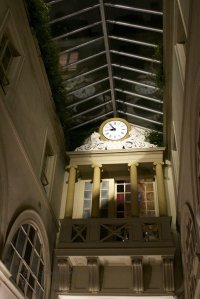 Passage Choiseul clock with refelections