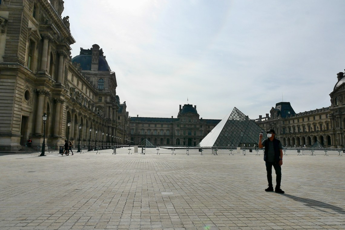 Image of Man taking selfie at Louvre Pyramid
