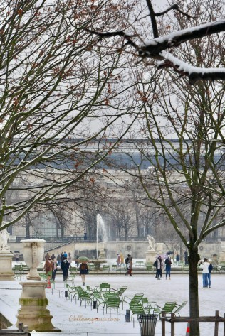 A Snow Day in Paris Jardin des Tuileries with green chairs