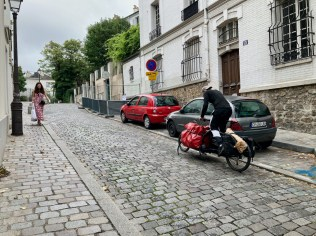Cyclists peddling up the hill of Rue Norvins