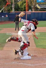 Colton Plaia jumps to avoid a sliding Michael Lorenzen.