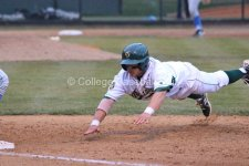 Denver Chavez dives back to first.