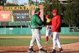 USC head coach Frank Cruz and Jacksonville assistant Tim Montez shake hands after the game