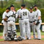 5/13/16 Storrs Connecticut: The Central Florida infield meets with head coach Terry Rooney (26) during an American Athletic Conference matchup. The Huskies defeated the Knights 5-4 at J.O. Christian Field in Storrs, Connecticut.
