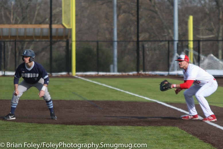 Monday, March 20, 2017; Northboro, MA; Gordon College Scots John Lagerfeldt (2) leads off first base with WPI Engineers first baseman Joe Fainer (15) during the Engineers come from behind 9-7 victory over the Scots at the New England Baseball Complex.