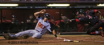 Justin Jones scores beyond the reach of SDSU catcher Hunter Stratton - Photo By David Cohen, BHEphotos