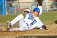 Wednesday, April 12, 2017; Rochdale, MA; Becker College Hawks infielder Christopher Testa (21) slides into home plate during the Hawks 9-2 victory over the Anna Maria Amcats.