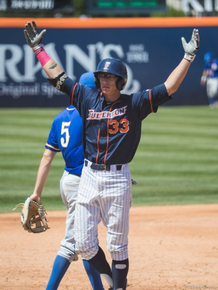 Hunter Cullen celebrates after his 2-run triple in the 3rd inning. CSUF defeated UCSB 12-3, Fullerton, CA, May 14, 2017. Photo by Steve Cheng, BHEphotos.