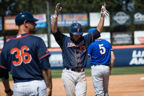 Timmy Richards celebrates his RBI triple in the 4th inning. CSUF defeated UCSB 12-3, Fullerton, CA, May 14, 2017. Photo by Steve Cheng, BHEphotos.