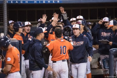 The Titans celebrate Daniel Cope's first career home run in the 6th inning. Saint Mary's defeated CSUF 12-4, Fullerton, CA, May 15, 2017. Photo by Steve Cheng, BHEphotos.