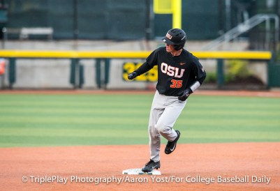 Oregon State catcher Adley Rutschman watches where his solo home run landed beyond right field as he rounds second. Rutschman's homer gave OSU a 1-0 lead over Oregon at PK Park in Thursday's Civil War game.