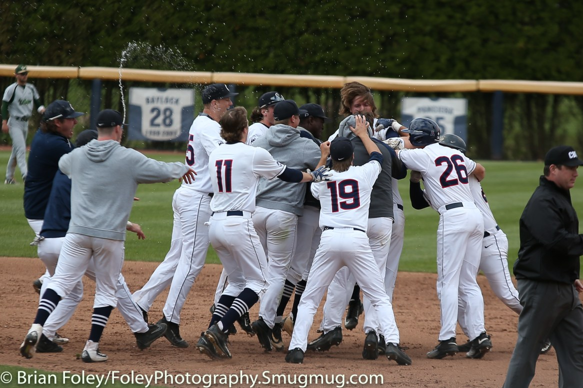 Friday, May 12, 2017; Storrs, CT; The Connecticut Huskies celebrate their 2-1 victory over the Bulls.