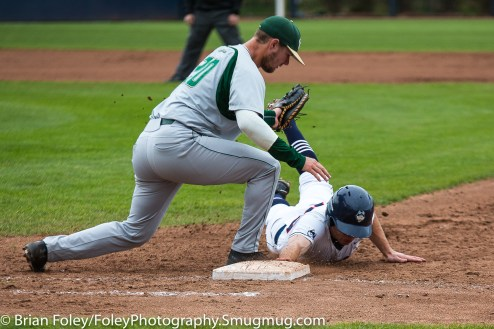 Friday, May 12, 2017; Storrs, CT; Connecticut Huskies infielder Conor Moriarty (20) dives back into first base during the Huskies 2-1 victory over the Bulls.
