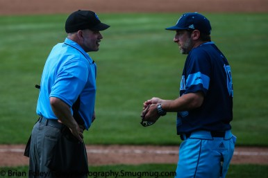 Thursday, May 18, 2017; Smithfield, RI; Rhode Island Rams head coach Raphael Cerrato talks to umpire Jeff Merzel during the Bulldogs 15-6 victory over the Rams.