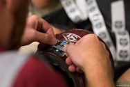 2017 College World Series, Day 1: FSU equipment trainers apply World Series decals on team helmets.