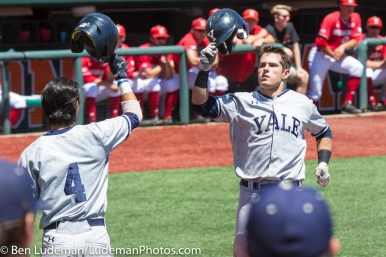 6/2/17, Goss Stadium Corvallis, OR: The Yale Bulldogs celebrate scoring a run during the Yale Bulldogs 5-1 win over Nebraska in the 2017 NCAA Baseball Tournament.