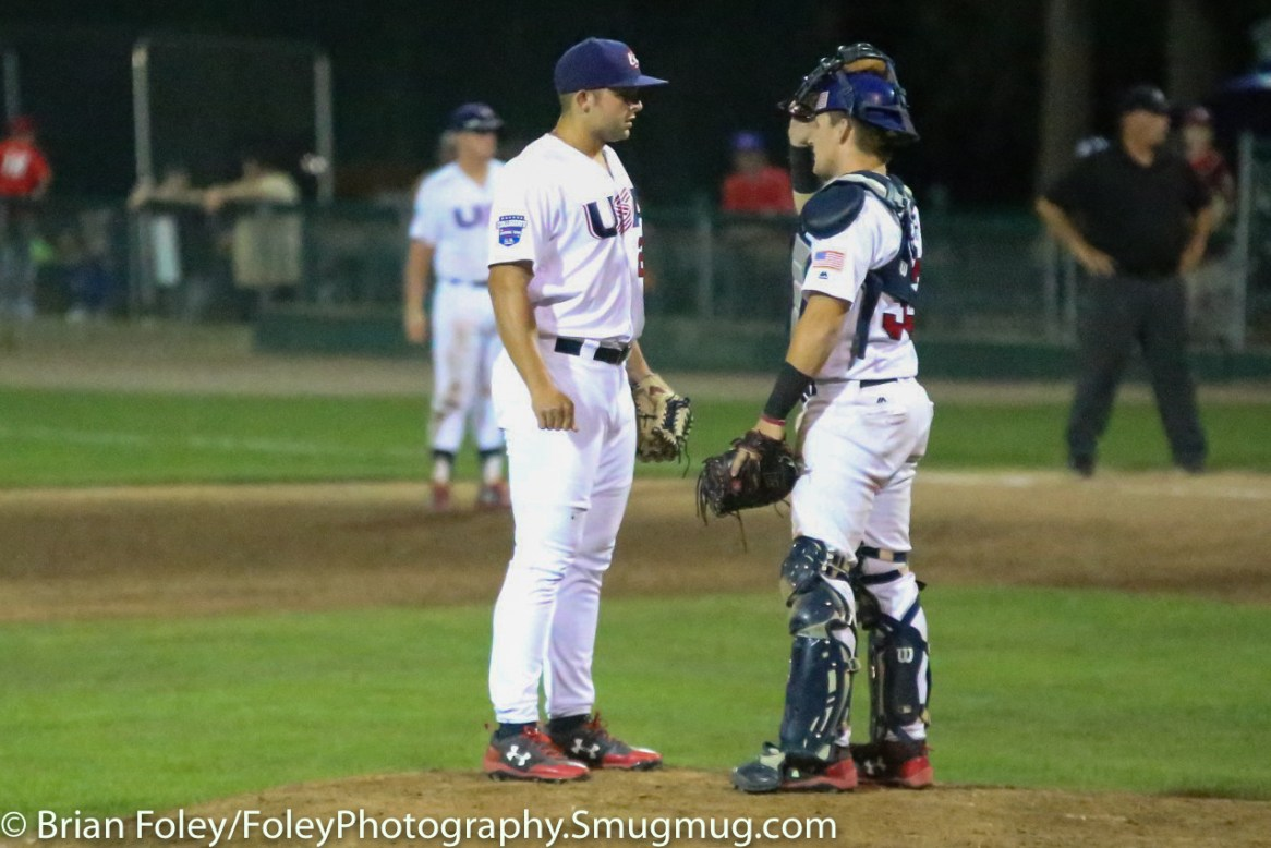 7/17/17, Holman Stadium, Nashua, NH: USA Collegiate National Team Dallas Woolfork (26) and USA Collegiate National Team catcher Grant Koch (33) meet at the mound during the USA Collegiate Team's 3-1 victory over the Japan Collegiate All-Star's at Holman Stadium in Nashua, New Hampshire.