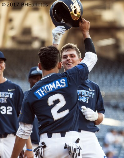Nolan Gorman is treated by Alek Thomas after hitting a 2 run home run - 2017 Perfect Game All American Game - Photo By David Cohen, BHEphotos