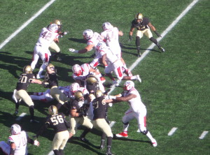 Rutgers' Robert Martin (7) scores from the five for a 21-7 lead.