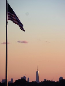 A beautiful, clear night to gaze on The Freedom Tower next to Old Glory.