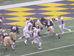 Navy starting QB Tago Smith scores early from the six-yard line.