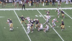 USNA LB Brandon Jones (3) got pressure on Anderson before he released this pass.