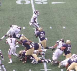 Navy FB Chris High (33) gains some of his 176 yards on this run.