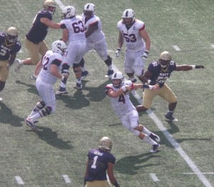 UConn QB Brant Shirreffs and the rest of the Huskies' running game were held in check by Navy early in the game.