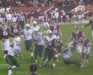 Owl RB Jahad Thomas runs for 11 yards before his nine-yard touchdown run.